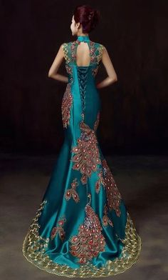 Peacock satin dress with train.