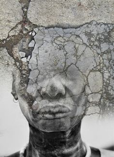 By Antonio Mora This tells a story. You can feel the tension and destruction. There is a sense that the face is becoming part of a wall and also that the cracks are tearing the figure apart.