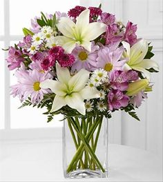 The Lavender Fields Mixed Flower Bouquet blooms with soft hues and an assortment of textures to create the perfect flower arrangement to send in honor of any of lifes special occasions!