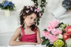 Portrait Of A Girl With Flowers In Her Hair, And In The Hands ...