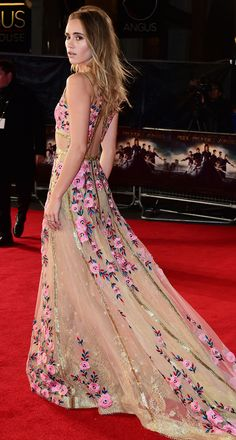 SUKI WATERHOUSEwears romantic floral-strewn Reem Acra with gold trim and glitter tears for the London premiere of Pride and Prejudice and Zombies.