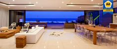 Beach house lounge room. Stunning views and beautiful colour blocks