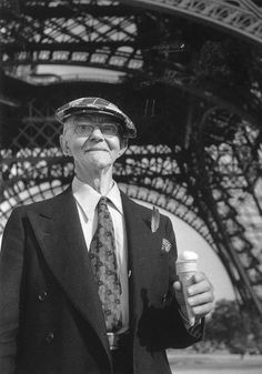 Robert DOISNEAU :: American Retired Tourist with Ice Cream Cone at Eiffel Tower, Paris, 1950