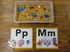 A simple corn bin adds a touch of sensory learning to this initial sound/letter sorting activity. (Free idea.)