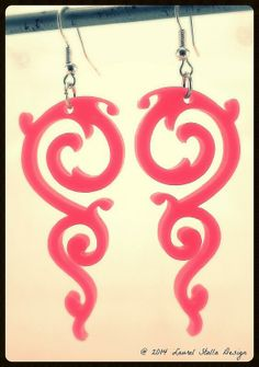 Pink Flourish Laser Cut Earrings These are bubble gum pink flourish earrings.  They are a popular item.  I think they are pretty but cool.