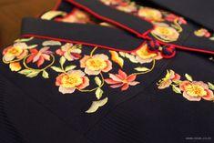 Flower pattern on dark fabric.