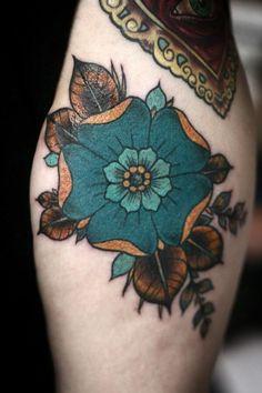 Stylized flower tattoo, orange, bronze, petrol, green, blue
