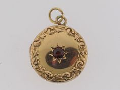 Antique 14k Yellow gold and Garnet Victorian locket