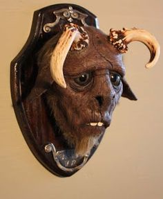 The taxidermy head of a small faun killed by a Spanish shoemaker in Creepy Pictures, Cryptozoology, Taxidermy, Mystic, Sculpting, Weird, Lion Sculpture, Skull, Creatures