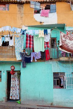 Colorful houses - Mexico Washing hangs down from colorful homes in a poor section of Cuernavaca. With Malcom Lowry in Under the Volcano Laundry Drying, Laundry Art, Mexico Travel, Mexico City, Hanging Out, Hanging Clothes, House Colors, Beautiful Places, Around The Worlds