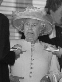 "Her expression is priceless!! ""Are you sure it's edible??"" The Queen normally has a say on what can be released to the Press, therefore this photo is AWESOME to capture this expression on her face!"