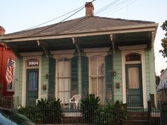 dark green shutters? http://noladetails.wordpress.com/2011/08/24/side-by-side-colors-2/