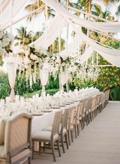 Floral chandeliers with simple table settings