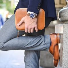 tan shoes and grey slacks