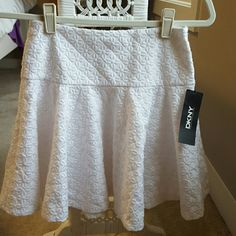 "NWT  DKNY white skirt. NWT. Fabric has flowers in a 3 D design 26"" waistline,  16 1/2"" long.Bundle and save  DKNY Skirts Midi"