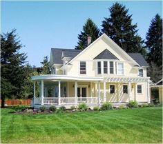 yellow farmhouse wrap around porch