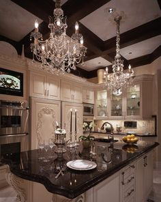 Beautiful antiqued white kitchen with beamed ceiling, decorative crown molding, acanthus corbels, and lovely crystal chandeliers / design by Beth Loren Whitlinger Interior