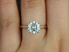 This delicate rose gold moissanite engagement ring: