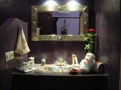 Candle light, rose petals and the smell of incense... romantic bathroom arrangement at the Riad Jona in Marrakech, Morocco.