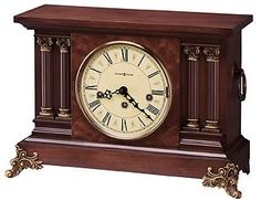 "The Howard Miller Circa 630-212 Keywound Mantel Clock has an antique-style featuring a lightly distressed finish.  It has decorative reeded columns frame and dial. A Carpathian elm burl veneer creates an additional point of interest. Aged to match the era, the dial features Roman numeral graphics. Finished in Americana Cherry. Key-wound, Westminster chime movement with chime silence option and durable bronze bushings. Size: H. 10-1/4"" W. 15-1/4"" D. 5-3/4"""