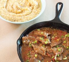 Tender beef smothered in a slow-roasted sauce served on a bed of creamy grits? Breakfast has never sounded better.