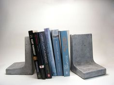 This is a listing for a set of concrete bookends. Modern and simple in shape, classic concrete texture, these are solid, heavy pieces that will keep