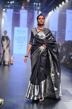 Model walks the ramp for designer Santosh Parekh on Day 6 of the Lakme Fashion Week Winter/Festive 2016 held in Mumbai. LFW Day Santosh Parekh Photogallery at Times of India Most Beautiful Dresses, Beautiful Saree, Ethnic Sarees, Indian Sarees, Indian Attire, Indian Outfits, Silver Outfits, Banaras Sarees, Saree Jewellery