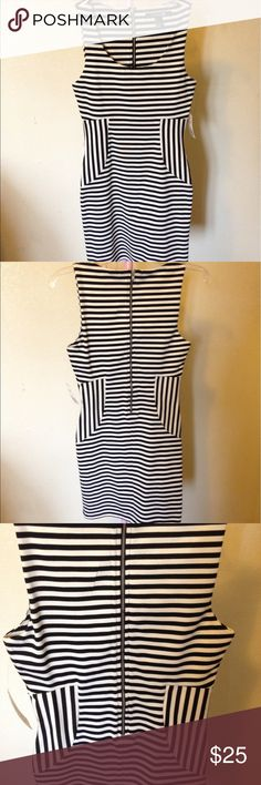 Body Con Stripped Dress Black and white stripes with vertical lines on the side to give the illusion of a slimmer waist. Perfect for a girls night out. Perfect condition new. Forever 21 Dresses Mini