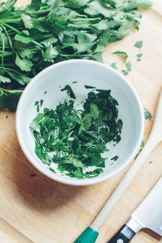 ERASE DARK CIRCLES WITH PARSLEY EYE MASK == Roughly chop a handful of parsley (preferably organic). In a small bowl, grind the leaves with a wooden spoon. Like muddling a drink, grind the parsley until it releases the juice in the leaves. Pour a tablespoon of hot water over the parsley and stir the mixture together. You can also combine the parsley with yogurt. When the water has cooled, use 2 cotton balls to soak up the juice. Lie down and keep the cotton ball under your eyes for 10…
