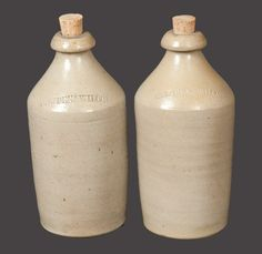 "Sold For $ 200 Two Salt-Glazed Stoneware Bottles, Stamped ""COWDEN & WILCOX,"" Harrisburg, PA origin, circa 1865, both of cylindrical form with tapered necks and blob tops, including ""COWDEN & WILCOX"" on shoulder. Both in excellent condition."