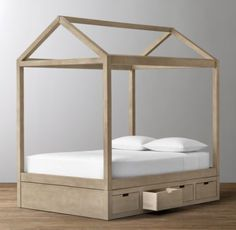 RH Baby & Child's Cole Storage Bed:The simple, A-shaped frame of an iconic American barn inspired our bed, which features stout beams on the long sides and triangular roof trusses at either end. A storage base with drawers on both sides offers space-saving efficiency.