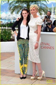 "Kristen Stewart & Kirsten Dunst.  Cannes2012.    Kristen - Balenciaga by Nicolas Ghesquière pants, Juicy Couture tank, Rebecca Minkoff jacket.    Kirsten - Dolce dress, Charlotte Olympia shoes, Van Cleef & Arpels' ""Alhambra"" watch."