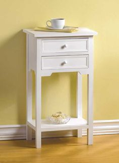 White Telephone Table. Decorative white wood telephone accent table with two drawers. This stylish accent table is great for a nightstand and will compliment any decor in your home.