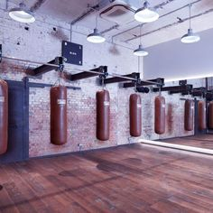 Blok London is a newly-opened fitness space located in a converted Victorian tram depot in Clapton. Looking more like a trendy art gallery than a gym, the space boasts two studios, London's first gym-based bone-broth bar and a host of carefully selected c Hiit, Boxing Gym Design, Accor Hotel, Warehouse Gym, Luxury Gym, Dream Gym, Gym Lighting, Fitness Gym, Trainer Fitness