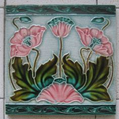 This a well known Richards design ,but I have not seen this version with the added blue  boarders c1906, this design reference is 278 in my book.Art Nouveau Tiles with Style.