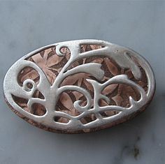 WIP brooch by lorahart. Love the idea of piercework on top of an etched layer.
