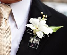 His parents are no longer with us, but it's nice to know they'll be close to his heart on the big day. | Groom Boutonniere Photo Memory Charms (via KCowie's Etsy Shop) @Ann Taylor @Style Me Pretty