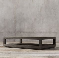 RH's Grand Framed Rectangular Coffee Table:A contemporary interpretation of a classic architectural element, our collection designed by Luay Al-Rawi is crafted of oak and characterized by its bold louver profile and clean, pared-down aesthetic. A low inset plinth base lends each silhouette the appearance of floating.