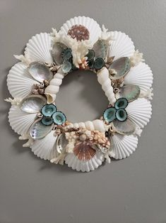 Scallop shell wreath with abalone and coral