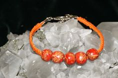 Orange Handcrafted Hemp with Orange Wooden Beads finished with a metal closure #Handmade #NewAge