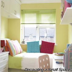 Hanging stock cabinets in a small bedroom ... may work for my little ones' rooms.  Hmmmm.
