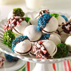 Chocolate-Dipped Meringue Sandwich Cookies Recipe -These light, airy morsels are twice as nice with two meringue cookies and velvety ganache in between. —Donna Pochoday-Stelmach, Morristown, New Jersey