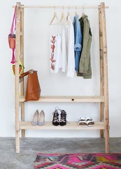 DIY ladder ward wardrobe. Alternative: I'd love to put shelves all the way up to turn this into a shoe shelf.