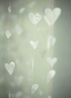 Paper hearts on a string, translucent