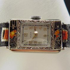 RARE antique Art Deco 14k Elgin enamel Lady & Tiger 1928 ladies wrist watch, via Etsy.