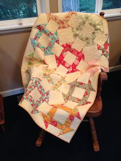 Churn dash baby quilt, made using Bonnie and Camille fabrics by Moda.