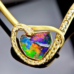 18k Yellow gold and Boulder Opal Pendant. Award winning piece from the Iskenderian collection. Available at www.thegemstoneco.com