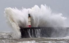 Newhaven #Lighthouse is battered by waves during stormy weather in Newhaven, #CT on the southern coast of England. More than 8,000 homes were without power in southwest England after fresh storms battered the region, sending huge waves crashing onto the coastline and damaging sea defenses. (Glyn Kirk/Getty Images)    http://dennisharper.lnf.com/
