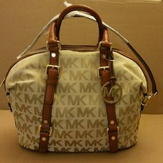 Michael Kors Logo Handbag Michael Kors Bedford signature satchel. A pocket on the outside, four inside pockets, and a zip compartment. Includes an adjustable shoulder strap. Gold accents. Zip closure. Michael Kors  Bags Satchels