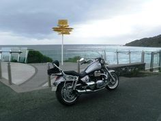 The Triumph Thunderbird at the southern most point of New Zealand - thinking about diving in, and swimming to Antarctica...